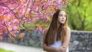 graphicstock-beautiful-girl-in-spring-garden-among-the-blooming-trees-with-pink-flowers_b0yst02-w